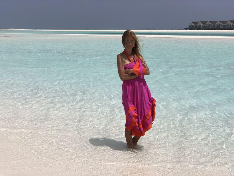 Norika na pláži rezortu lux south ari atol