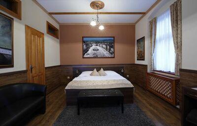 Posteľ na izbe v hoteli Kúria