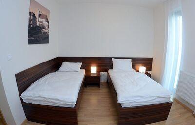 Izba s oddelenými lôžkami v hoteli Belier