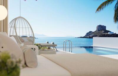 Izba s vlastným bazénom a výhľadom na more v hoteli Ikos Aria