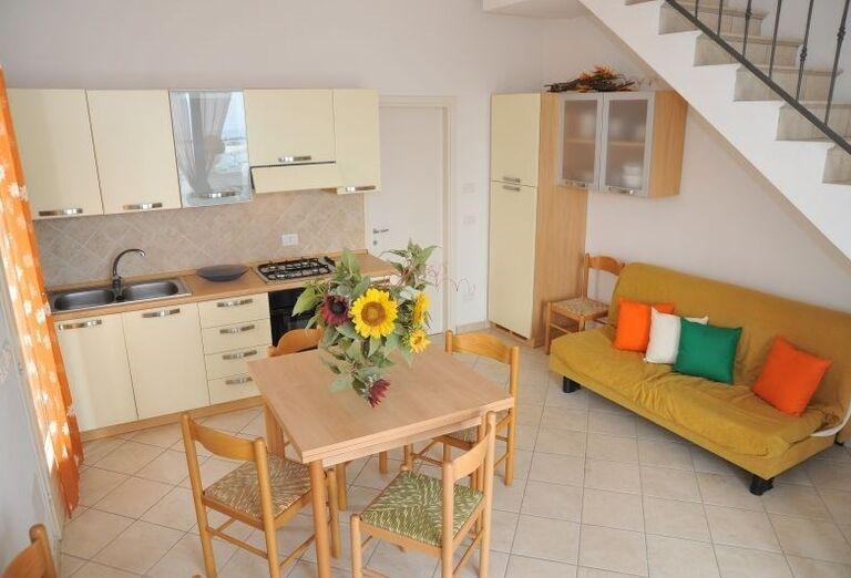 Jedálenský a obývací kút v rezidencii Airone Bianco