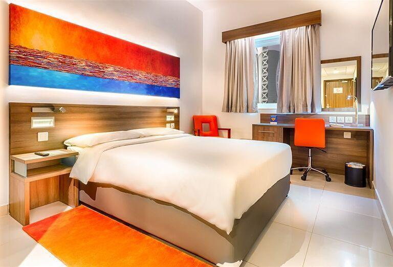 Manželská posteľ v izbe v hoteli City Max Al Barsha at the Mall